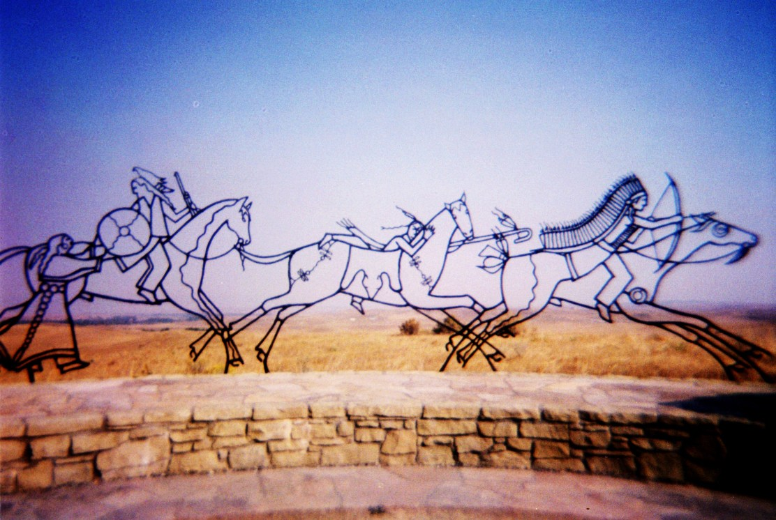 Sculpture by Oglala Sioux artist Colleen Cutschall (alias Sister Wolf) depicting Lakota and Cheyenne men fighting at the Little Bighorn Battlefield