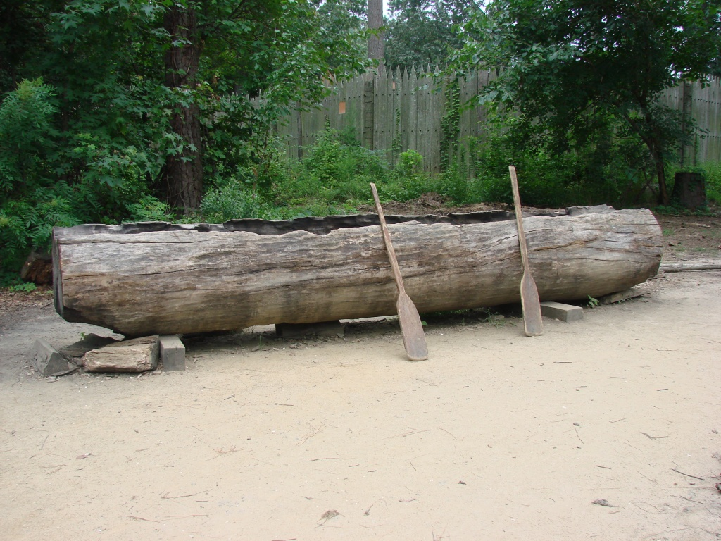 log hollowing to make a canoe