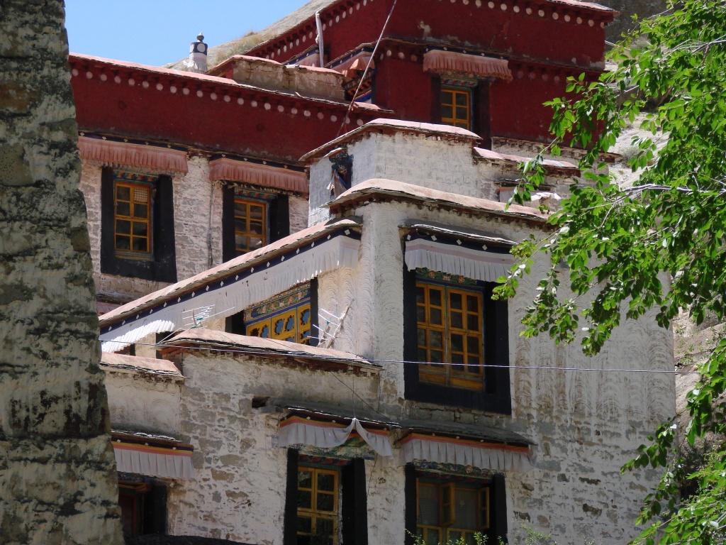 top of Tibetan structures dressed in dark crimson