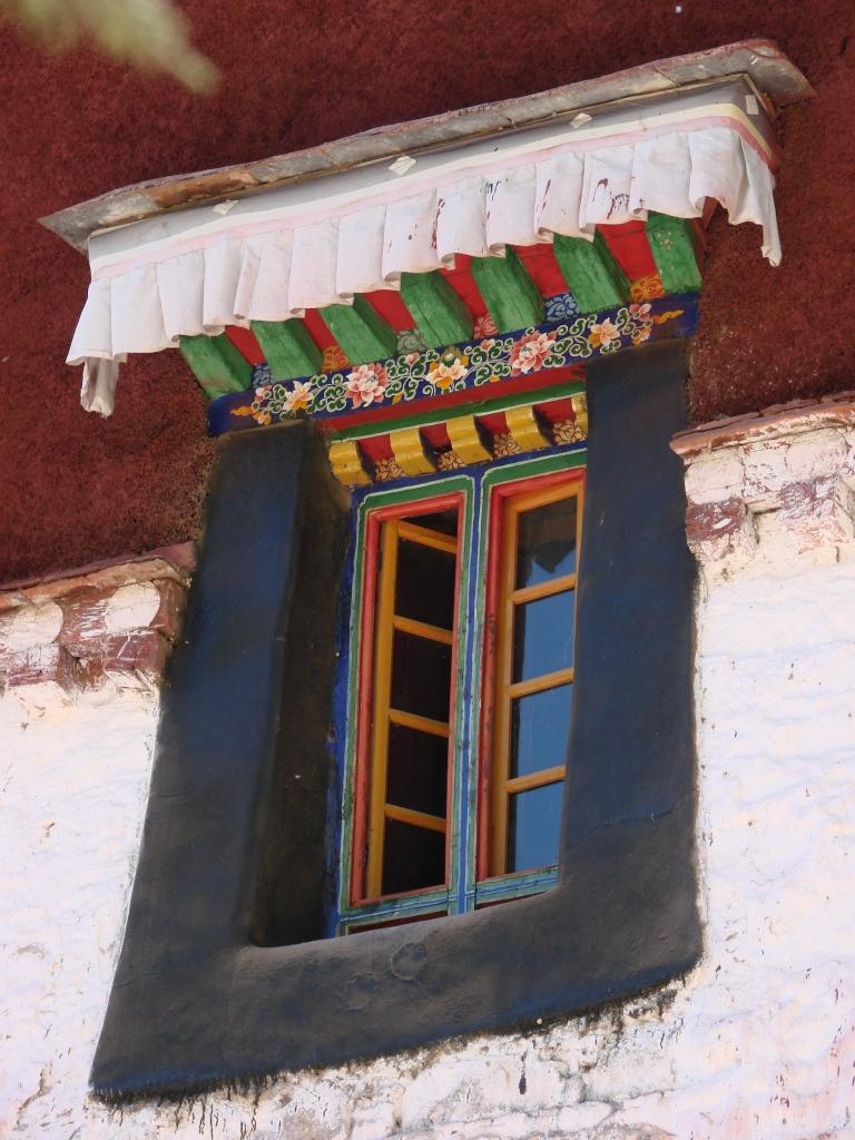 Tibetan design - chain of flowers painted with gold, orange, crimson, and dark indigo