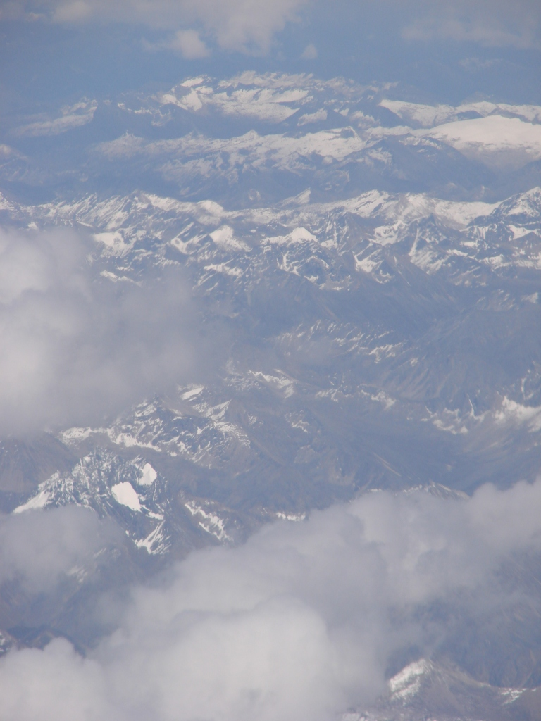 view from an airplane of the Himalayas