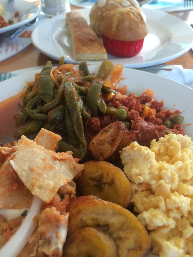 chilaquiles, cactus dish, chorizo, fried plantains, and eggs - breakfast from Yucatán