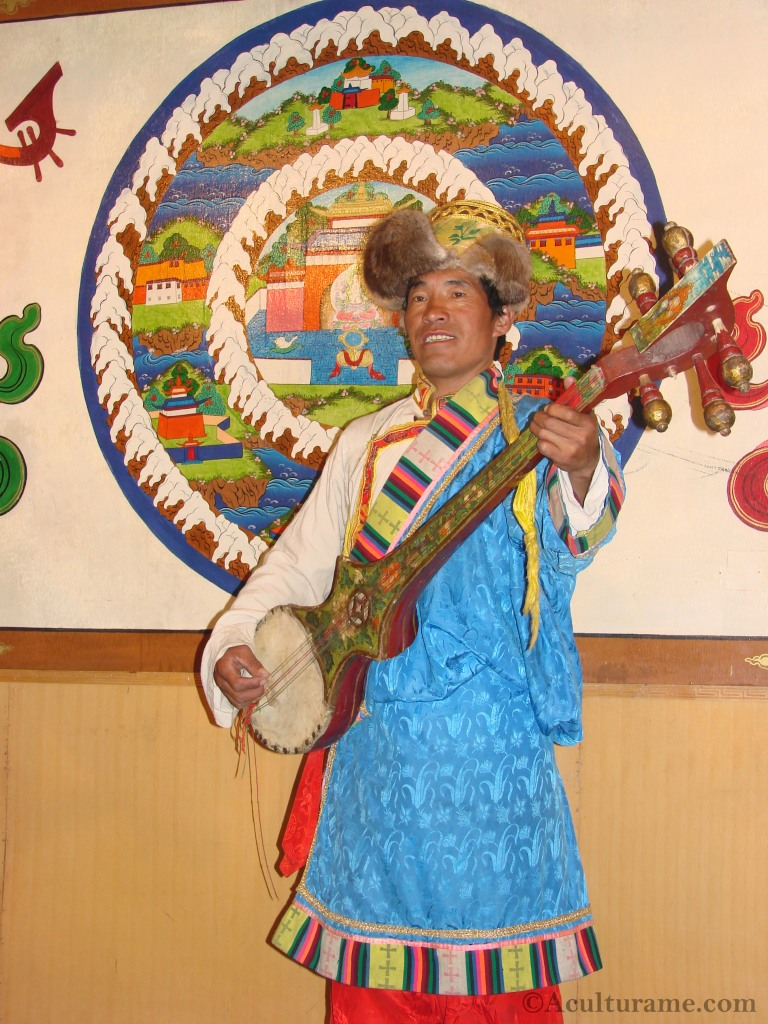 Tibetan Performer Playing a Dramyin