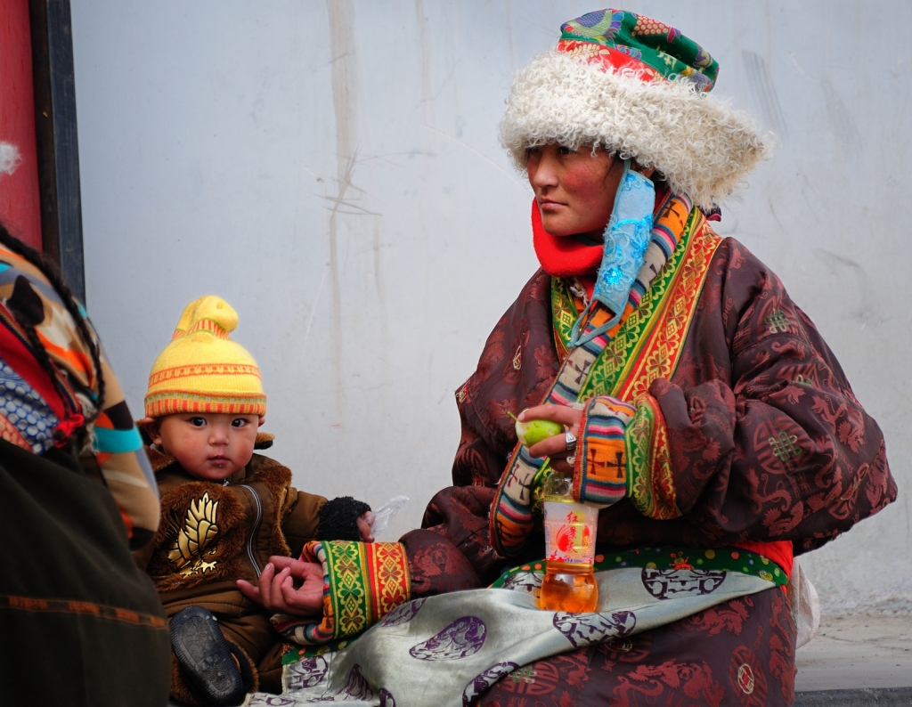 A Tibetan woman wearing a traditional chuba Photo Credit: Jan Reurink