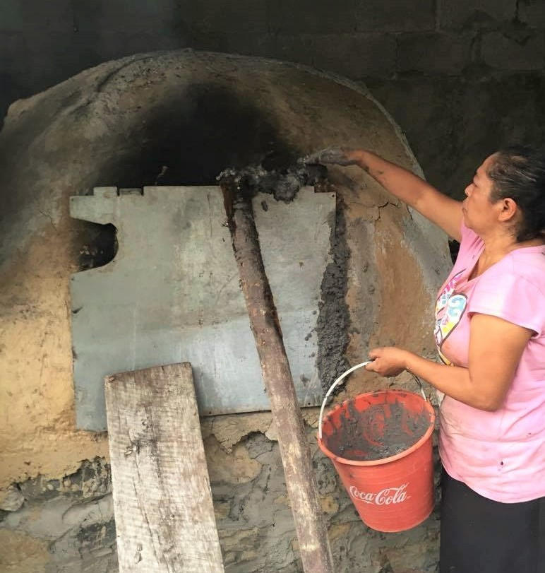 zacahuil is placed inside adobe oven and sealed with cement